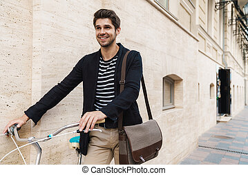Cheerful business man outdoors on a bicycle