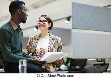 Cheerful Business Manager Talking to Intern