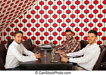 Cheerful business men at meeting