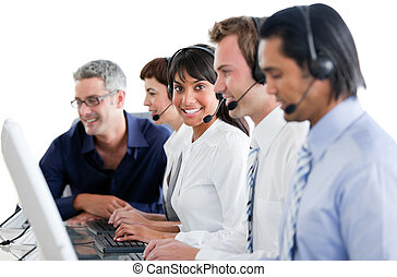 Cheerful business people working in a call center