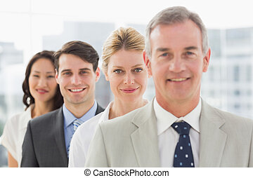 Cheerful business team standing in a line