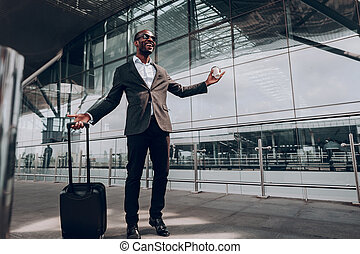 Cheerful business traveler feeling happy after the flight