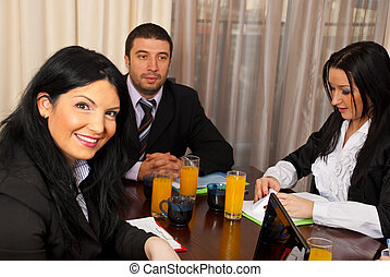 Cheerful business woman at meeting