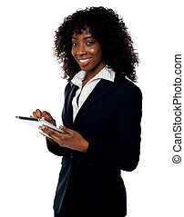 Cheerful business woman using tablet pc