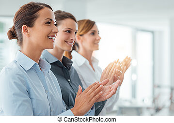 Cheerful business women applauding