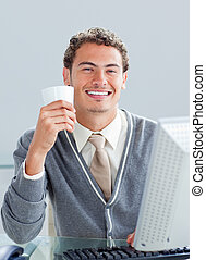 Cheerful businessman drinking a cup of coffe