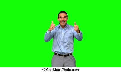 Cheerful businessman giving thumbs up