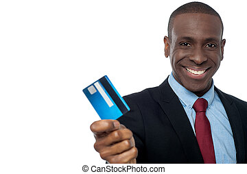 Cheerful businessman holding credit card - Young corporate ...