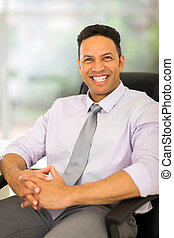 businessman in office looking at the camera