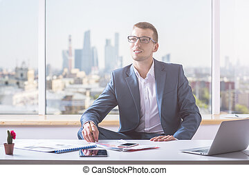 Cheerful businessman in suit