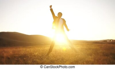 Cheerful businessman jumping - Happy businessman jumping on...