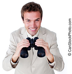 Cheerful businessman looking through binoculars