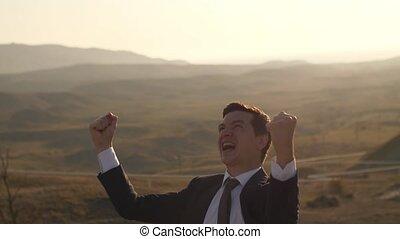 Cheerful businessman on nature