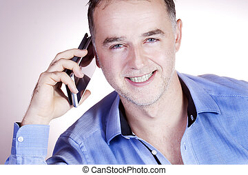 Cheerful businessman on the phone.