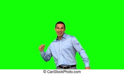 Cheerful businessman raising his fist