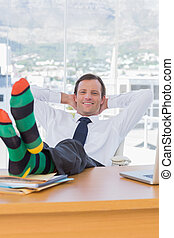 Cheerful businessman relaxing with