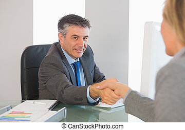 Cheerful businessman shaking hand