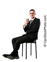 Cheerful businessman sitting with cup of coffee over white background