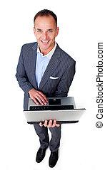 Cheerful businessman using a laptop