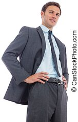 Cheerful businessman with hands on hips