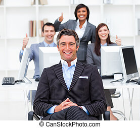 Cheerful businesspeople with thumbs up