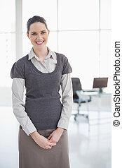 Cheerful businesswoman posing