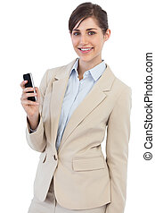 Cheerful businesswoman posing with phone