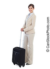 Cheerful businesswoman posing with suitcase