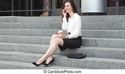 Cheerful businesswoman speaking on smartphone - Attractive...