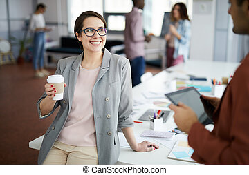 Cheerful Businesswoman Talking to Colleague on Break