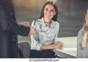 Cheerful businesswoman working in office