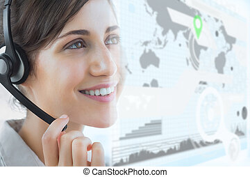 Cheerful call center employee using futuristic interface...