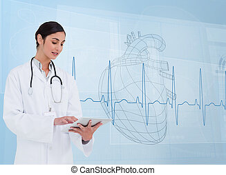 Cheerful cardiologist using a tablet pc in front of...