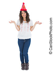 Cheerful casual brunette with party hat posing
