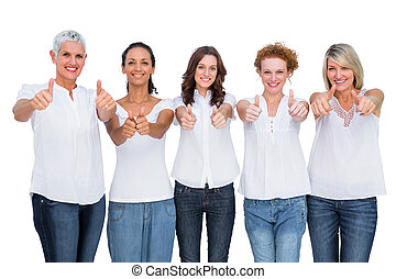 Cheerful casual models posing together with thumbs up
