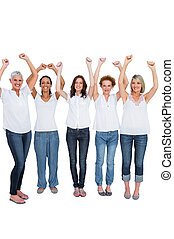 Cheerful casual models posing with hands up