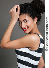 Cheerful charming african american young woman with red lips
