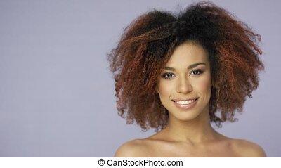 Cheerful charming ethnic model