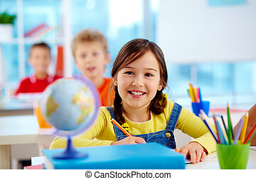 Cheerful child - Image of a cute pupil with cheerful smile