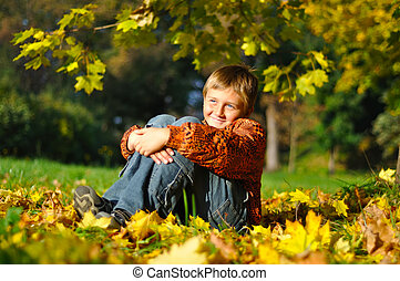 Cheerful child in autum meadow