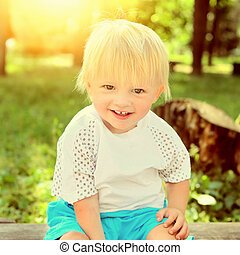 Cheerful Child outdoor - Toned Photo of the Cheerful Child...