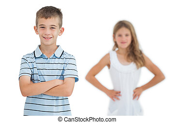 Cheerful child posing with his sister on background