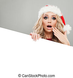 Cheerful Christmas Woman in Santa Hat with White Banner Background. Winter Woman Christmas Concept