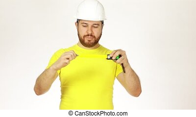 Cheerful construction engineer or architect in yellow tshirt...