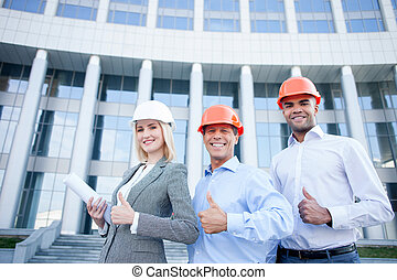 Cheerful construction team is working with joy