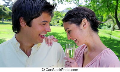 Cheerful couple celebrating an event