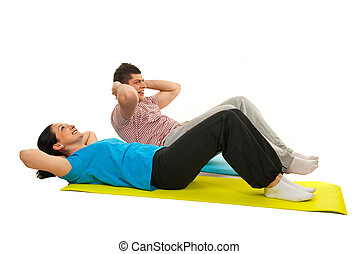 Cheerful couple doing abs
