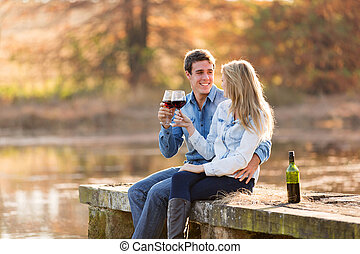 couple enjoying glass of red wine