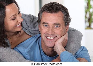 Cheerful couple hugging