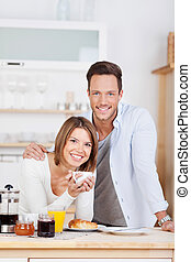 Cheerful couple in the kitchen